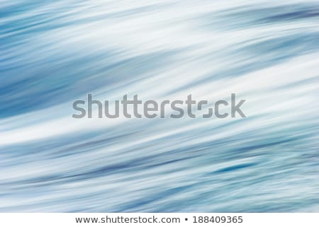 blue river water texture volcanic rolling stones Stock photo © lunamarina