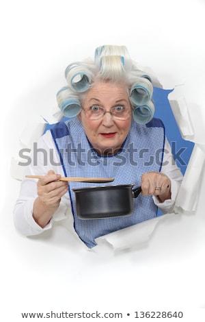 Elderly lady stirring sauce pan Stock photo © photography33