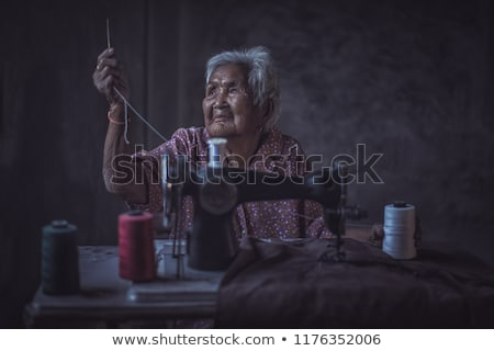 Elderly lady using sewing machine Stock photo © photography33