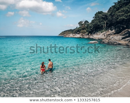 Couple laying on a beach Stock photo © photography33