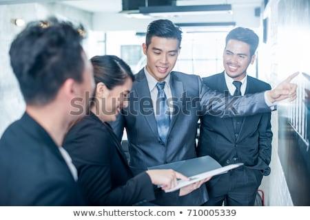 Giovani sud-est asian executive piedi ufficio Foto d'archivio © szefei
