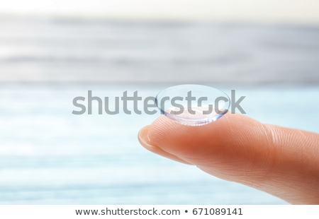 woman hold contact lens on finger stock photo © imarin