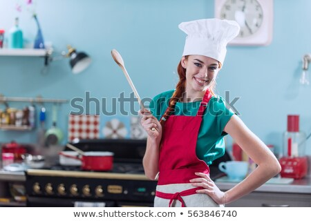 Portrait of a woman posing in her kitchen stock photo © wavebreak_media