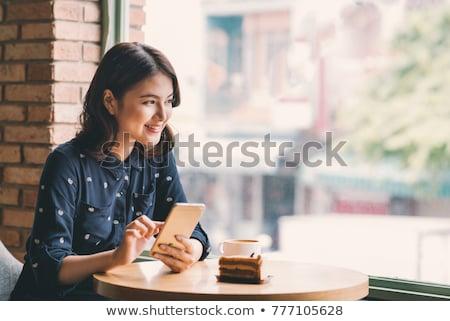 Fiatal üzletasszony mobiltelefon portré vonzó ázsiai Stock fotó © williv