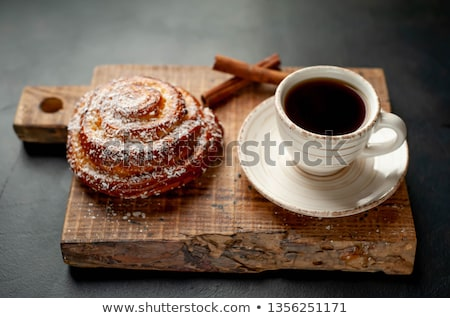 cinnamon bun and coffee stock photo © dehooks