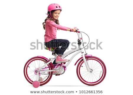 Little girl riding a  bicycle stock photo © Len44ik