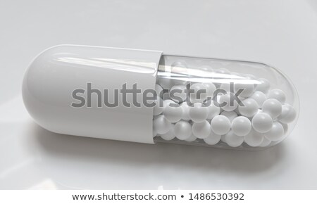 Pillen capsules Blauw Geel capsule Stockfoto © iqoncept