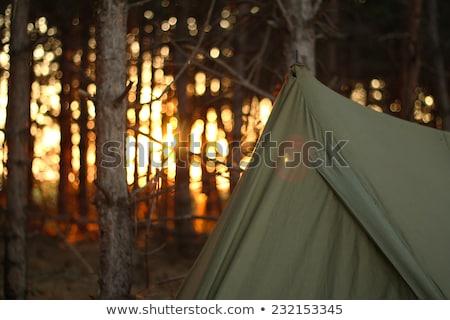 Tent Silhouettes in the Sundown Stock photo © Nelosa