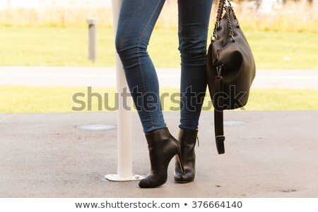 long legs in tight leather pants stock photo © elisanth