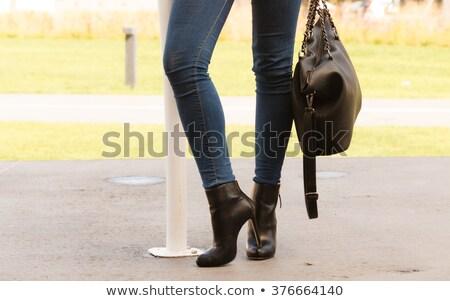 Hosszú lábak szoros bőr nadrág magassarkú stúdiófelvétel Stock fotó © Elisanth