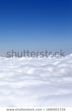Snowy mountains and off-piste slope in morning haze Stock photo © BSANI
