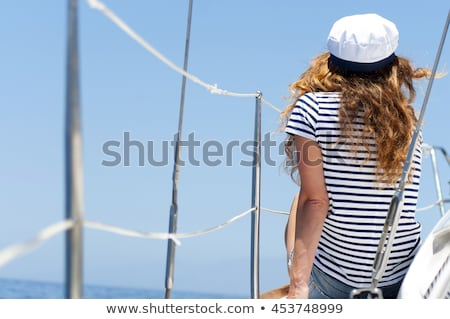 Beautiful girl in captain's hat on a yacht Stock photo © Nejron