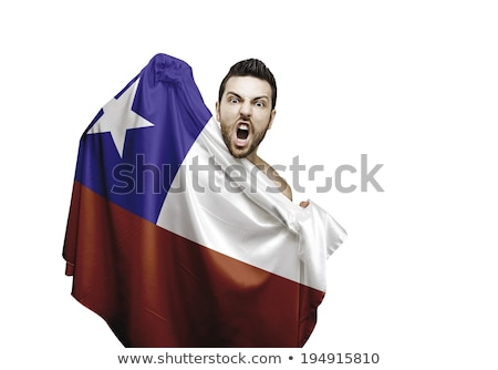 Happy soccer fan holds Chile flag Stock photo © orensila