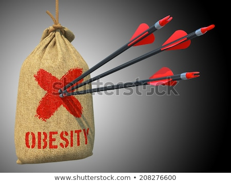 Obesity - Arrows Hit in Red Mark Target. Stock photo © tashatuvango