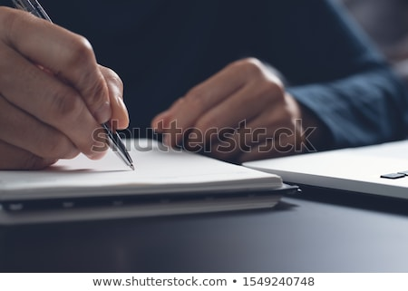 businessman with pen and notepad Stock photo © PetrMalyshev