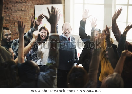 Group of cheerful business team applauding Stock photo © deandrobot