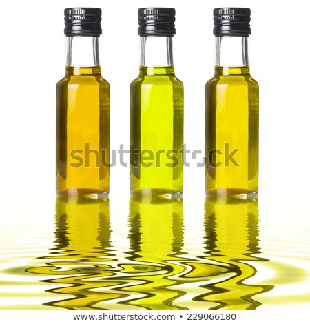 Extra virgin olive oil three glass jars isolated Stock photo © marimorena