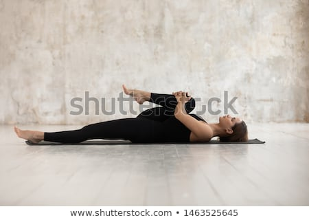 young woman wearing black sport clothes stock photo © acidgrey