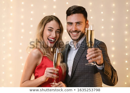 man with a glass of champagne date holiday toast Stock photo © studiostoks