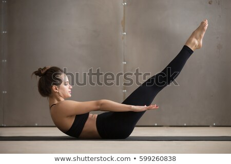 Pilates woman double leg stretch exercise workout Stock photo © lunamarina