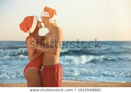 Christmas beach vacation travel woman in Santa hat stock photo © Maridav