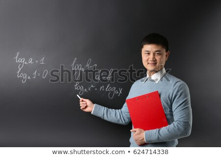 smiling math teacher at flipboard in classroom Stock photo © dolgachov