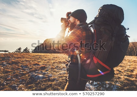 Hipster photographer exploring nature Stock photo © stevanovicigor