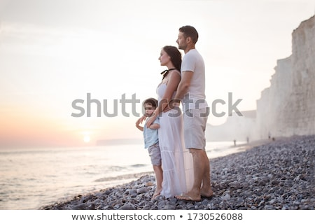 Daddy with mummy and child in sea on sunset stock photo © Paha_L