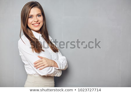 smiling attractive young business woman with hands folded stock photo © deandrobot