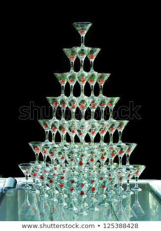 Pyramid of Champagne Glasses with Color Cocktails Stock photo © dariazu