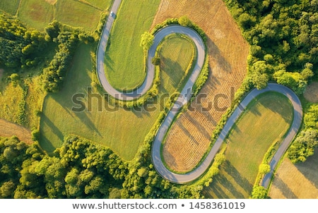 a plane above the winding road stock photo © bluering