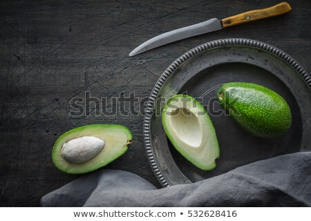 Avocado on the dark scratched table top view Stock photo © Karpenkovdenis