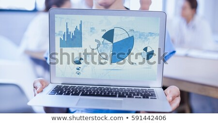 mid section of nurse showing graph on laptop stock photo © wavebreak_media