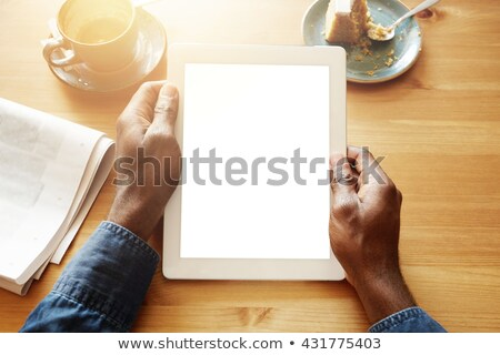 cropped image of smiling man showing blank tablet computer screen stock photo © deandrobot