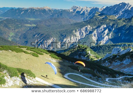 Stock photo: Paragliders flying over Bavarian mountains