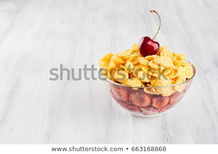 Stock photo: Healthy Breakfast In Bowl With Golden Corn Flakes Decorated Cherry On White Wood Board Decorative B