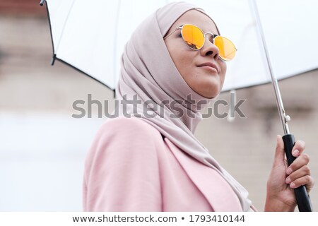 close up of muslim woman in hijab and sunglasses stock photo © dolgachov