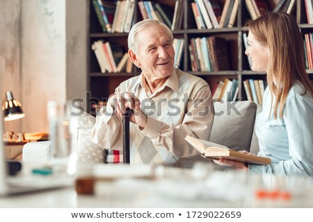 Portrait of young woman in library Stock photo © IS2