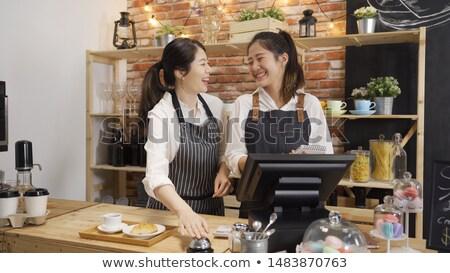 Sorridere cameriera campana counter ritratto bar Foto d'archivio © wavebreak_media