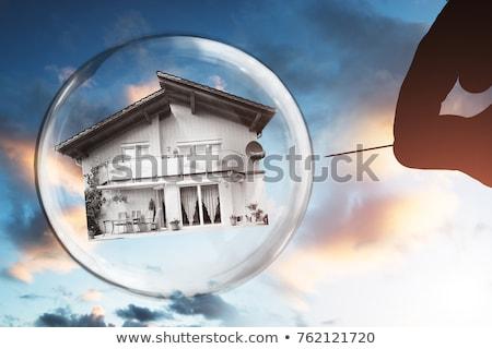 Menschlichen Hand Blase Nadel Haus bewölkt Himmel Stock foto © AndreyPopov