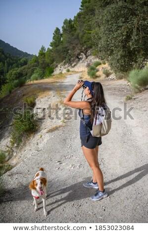 girl with binoculars walking the dog stock photo © is2