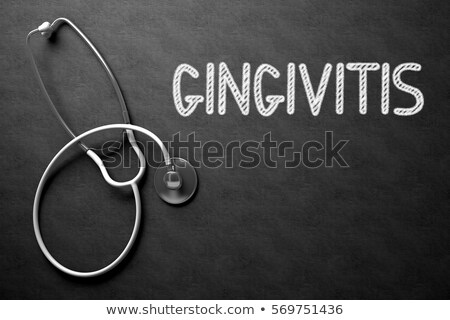 gingivitis handwritten on chalkboard 3d illustration stock photo © tashatuvango