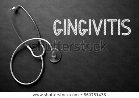 Gingivitis Handwritten on Chalkboard. 3D Illustration. Stock photo © tashatuvango