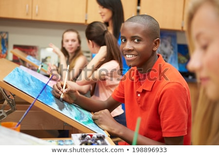 Teacher teaching students art & crafts Stock photo © IS2