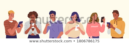 boy and girl with mobile phones stock photo © is2