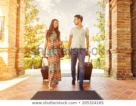 Couple arriving at hotel holding hands Stock photo © IS2