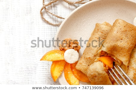 Caseiro panquecas pêssegos mel monte nozes Foto stock © mpessaris