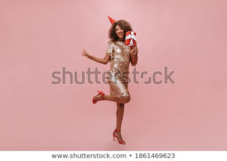 Full length photo of charming adult woman with curly hair in dre Stock photo © deandrobot