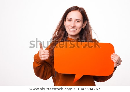 portrait of a happy young woman holding photo camera stock photo © deandrobot