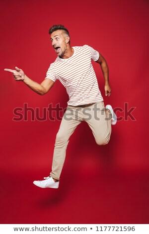 Teljes alakos fotó felnőtt férfi csíkos póló Stock fotó © deandrobot